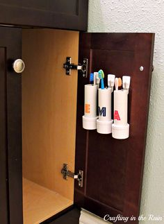 PVC Pipe Toothbrush Holders. Brilliant! Gets them off the counter and put out of the germ zone.