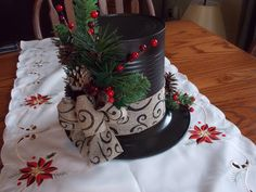 Love the burlap ribbon on this centerpiece. Tin Can Centerpieces, Christmas Centrepieces, Christmas Hats, Christmas Wreaths, Christmas Decorations, Snowman Hat, Snowman Crafts, Homemade Crafts, Diy Crafts