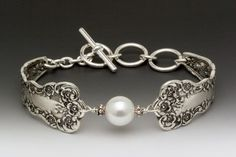 Love this type of jewelry...a great way to use vintage silver and the pearl is perfection!