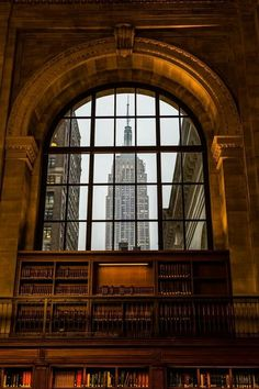 A beautiful image from inside the New York Library with a view of the Empire State Building.