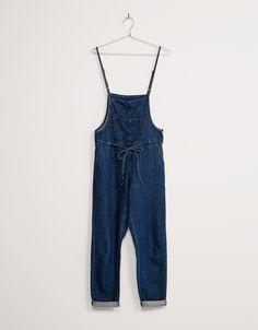 Peto denim BSK fino atado cintura. Descubre ésta y muchas otras prendas en Bershka con nuevos productos cada semana