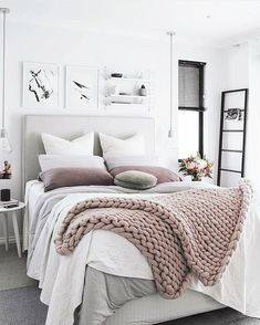 Love the blankets, shelf and photo above bed