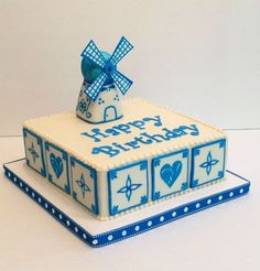 Buttercream cake with hand painted fondant tiles and 3d windmill ...
