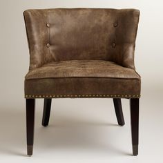 distressed soft leather, super comfortable. nailhead accents and tufting detailing. smaller size makes it an option for more layouts | Bennett Chair | World Market #distressed #leather #chair