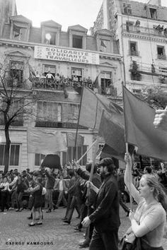 """Paris Demonstrations, May, 1968. The banner reads """"Solidarity between Students and Workers""""."""