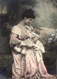 Victorian mother nursing. To think that there is still public debate in 21st century Australia about whether mums should breast feed in public. Legally mothers can nurse wherever they like. Get over it.