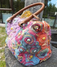 Freeform crochet inspiration --- Ravelry: theobald's encore des ronds; What a great bag!
