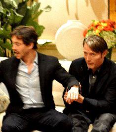Hugh Dancy and Mads Mikkelsen goofing off at a press event for Hannibal.