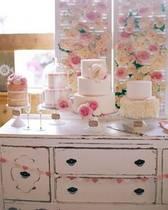 Rosy Display...nstead of one wedding cake, this couple set up a buffet with five cakes in different styles. Vintage shutters adorned with garden roses proved a pretty backdrop.