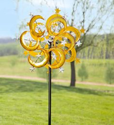 Our Crescent Moon and Stars Wind Spinner will brighten your landscape with its glittering gold and silver finish. Each of the dual rotors features six shiny golden crescent moons along with 13 silver-colored stars. Made entirely from metal, each moon and star is covered with a shiny foil-like coating that produces a crackled, sparkly finish.