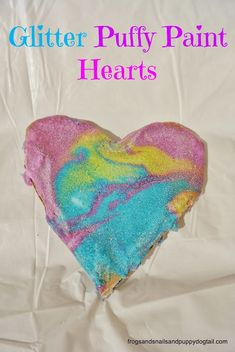 DIY Glitter Puffy Paint to Make Valentine's Day Hearts (1 c. each flour, salt, and water, with glitter, ziplocs, food coloring, and cardboard cutout shaped hearts)