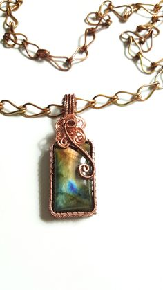 Copper and Bronze Wire Weave pendant with Multi Flash Labradorite Cabochon approximately .75x2 inches, with Orange, Green and Blue flash. It is on a 20 inch handcrafted copper chain.  Every angle of light picks up different colors, absolutely gorgeous! !  As with all my pieces, this is a one of a kind item. | Shop this product here: spreesy.com/FriendsCrafts/119 | Shop all of our products at http://spreesy.com/FriendsCrafts    | Pinterest selling powered by Spreesy.com