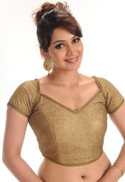 Beige coloured self-pattern, stitched saree blouse for women by Salwar Studio. It is Made from brocade.