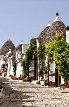 Streets of Alberobello, Italy. Alberobello is well known and appreciated for the characteristic trulli, ancient dry stone conical buildings, with a central plan. Most are located in the typical quarters of Monti and Aia Piccola, where they are used as houses, bars and shops, but the trulli are extended to all areas of the Murgia hills. They have been declared World Heritage by UNESCO in 1996.