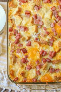 Cheesy Ham n Cheese Strata - this butter-y breakfast casserole is easy and a hit for any brunch or holiday!! With eggs, cheese, bread and butter you can't go wrong.