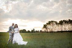 Izelle Labuschagne Photography from Broke Ass Bride - wedding photo couple pose scenic background field green ampersand beautiful art