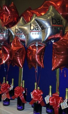 Corporate balloons tied to champagne for celebratory events Balloon Centerpieces, Balloon Decorations, Balloon Logo, Event Planning Tips, Event Ideas, Event Branding, Bridal Flowers, Corporate Events, Event Decor