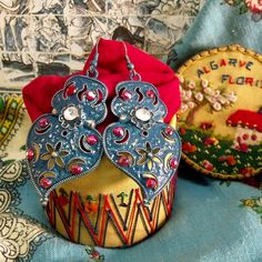 Portuguese folk jewelry Hearts of Viana style Blue dangle earrings with Red rhinestones. It is my modern version of Portugal traditional lacy hearts jewelry.$39.95..#madeinPortugal#portuguesejewelry#vianahearts#portugalfolkart#portugal#vianaheartearrings