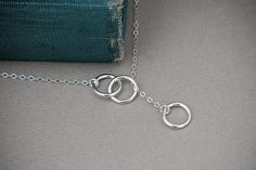 Hey, I found this really awesome Etsy listing at https://www.etsy.com/listing/103595252/interlocking-rings-lariat-solid-sterling