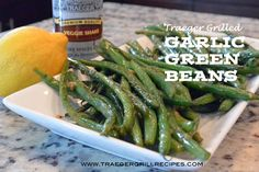 Traeger Grilled Garlic Green Beans. These are the perfect Traeger side dish to any bbq main dish!