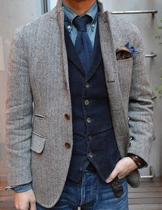 herringbone sport coat, corduroy vest, tie, denim.  Terrific (mis)matching.
