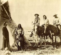 A Christian Priest visiting with an Apsaalooke family - 1890