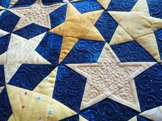 Love the quilting...next to the ditch and then fill in with stippling.