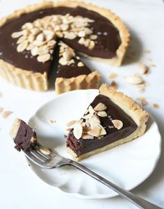 Dark Chocolate & Almond Tart. Gluten free, dairy free and paleo. Recipe on www.thelittlegreenspoon.com