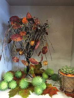 Wire sculpture with Autumn fruits