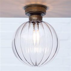 A round, handmade flush fitting light, with hand blown clear glass. One of many beautiful lighting solutions Industrial Ceiling Lights, Flush Ceiling Lights, Porch Lighting, Bathroom Lighting, Light Bathroom, House Lighting, Light Switches And Sockets, Curved Glass, Spots