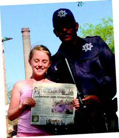 Romy Gates sharing The Taos News with a Federale friend in El Triunfo Baja California.