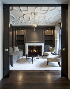 love the ceiling, dark wood flooring, and white furniture!