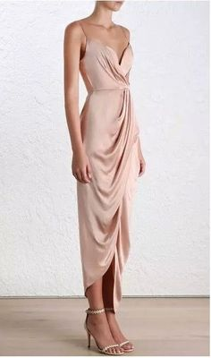 Ethereal and alluring, the Sueded Silk Plunge Long Dress paints the picture of luscious silk dancing down the body. The fluid-like draping is contrasted with a structured bustier. Dry clean only. Red Silk Dress Looks You Need To Try This Valentine's Day Silk Bridesmaid Dresses, Satin Dresses, Elegant Dresses, Beautiful Dresses, Prom Dresses, Gowns, Formal Dresses, Wedding Dresses, Long Dress Formal Elegant