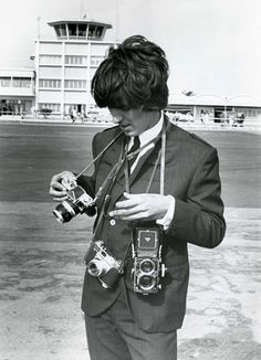 George Harrison with a Rolleiflex, a Yashica Electro 35, and what appears to be a Pintax 35mm