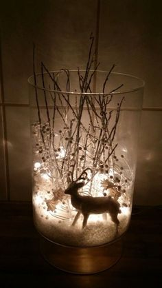 I took a vase, fake snow, a white reindeer, silver tree branches, decorations of white pearls and flowers as well as white Christmas lights and I created a winter wonderland to illuminate the dark days we live in Iceland. White Christmas Lights, Noel Christmas, Rustic Christmas, Simple Christmas, Winter Christmas, Christmas Crafts, Christmas Ornaments, Beautiful Christmas, Xmas Lights