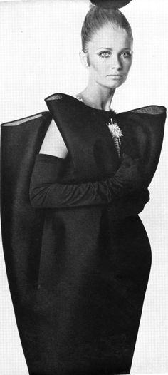 A Balenciaga dress of black gazar, suspended like butterflies in mid-air on diamanté straps and drawn close towards the knees; as described by Vogue. The wings are indented with a single diamanté jewel. Photo from Vogue, September 1967.