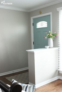 Love this so much more than the door being the same color as the trim! Great way to further pull in accent colors.