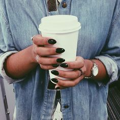 Black pointed nails.