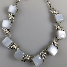 Vintage Unsigned Coro Lt Blue Moonstone Necklace Excellent condition. Normal amount of excess glue showing. 16 inch x 0.5 inch. Vintage Jewelry Necklaces