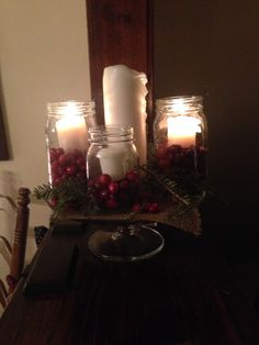 Advent wreath with mason jars and cranberries.