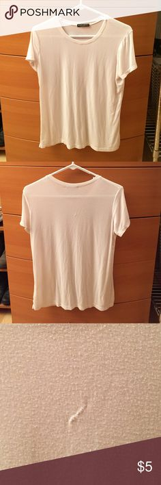 Brandy Melville Loose White Tee A basic loose fitting white t-shirt from Brandy Melville. Best fits XS-S. WORN, some pilling and stitching on the back of shirt as shown. Brandy Melville Tops Tees - Short Sleeve