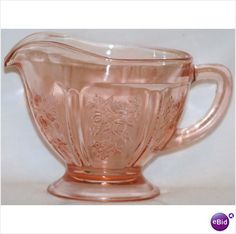 """Creamer - Sharon Cabbage Rose - one of the most popular patterns among collectors of Depression glass, the Sharon pattern, also known as Rose Glow, is recognized for its timeless and classis beauty. This Pattern by Federal Glass is one of the most recognized Patterns of Depression Glass. It was introduced in 1935 and produced until 1939. Cabbage Rose Creamer, approx: 4 1/4""""W x 3""""H; no cracks or chips."""