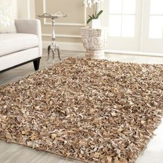 ONE IN STOCK - Metro-Leather Shag Rug: 3.5' x 5.5' (true size not shown)- Rent: $19; Buy: $59.