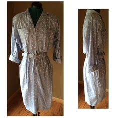 """Vintage Belted Blue Shirtdress Really beautiful and timeless vintage shirt dress from Virgo II.  Heavily padded shoulders (can be taken out to modernize) Elastic and belted waistband, two front pockets.  Buttons to waist and then zips down below.   Condition: EUC - fabric has a few areas of wear, but this dress still has a lot of life left in it.   Material: - tags missing, feels like a lightweight cotton blend Size: 10 Shoulder to Shoulder: 17"""" Pit to Pit: 21"""" Waist: Minimum 26"""" LOTS OF…"""
