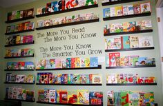 The Book Wall in our kids playroom.  We want to encourage the love of reading, so we made it the focal part of the room.  The display shelves make it easy for my kids to see and access the books.