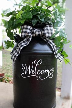 "Recycled ""Welcome"" Milk Can : Gallery : A Cherry On Top--would love to recreate this with cattails and burlap ribbon for fall!"