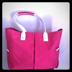 """New pink/white canvas with patent shoulder LG TOTE This tote is very feminine and ultra cute! It is large and made of canvas it is sturdy and new. . Has pretty pink patent padding on the straps shoulder area for comfort Carry. This bag was designed exclusively for Lancôme . Argent roomy and her pink and white striped area, modeled on manikin that is a size 10 and 5 foot nine. Measures at 14"""" x 11"""" x 4"""" with a double strap drop of 7.5"""". Has a slip pocket on each side. Adorable bag for the…"""