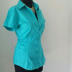 New ruched blouse Button down front with ruched sides and thick stitch seaming in front and back. Gorgeous teal color. New York & Company Tops Blouses