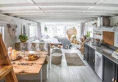 """'Trading Spaces"""" Genevieve Gorder on the Most Common Design Mistake She Sees—And How to Fix It - workflow. House Boat, Boat House Interior, Home, Lakefront Living, Genevieve Gorder, Floating House, Houseboat Decor, Rustic Design, Houseboat Living"""