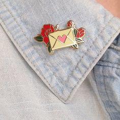 1 hard enamel lapel pin in gold metal. Butterfly clasp back.
